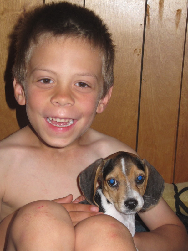 My son, Zane, holding his new Beagle puppy:    Cowboy!